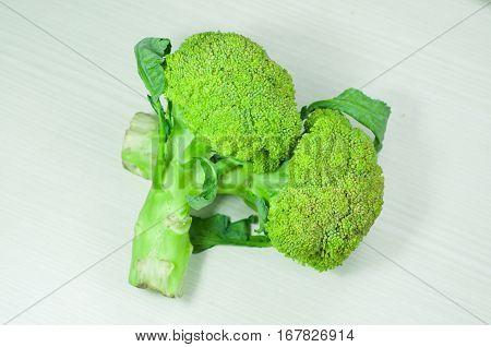 broccoli over white wood. broccoli isolated. vegetable green broccoli