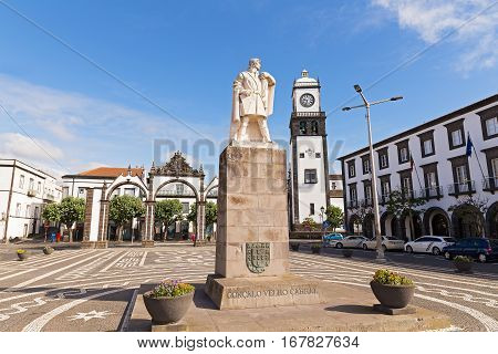 Main square of Ponta Delgada with statue of Goncalo Velho Cabral in Azores. Portas da Cidade Gates and Saint Sebastian church with clock tower located there.