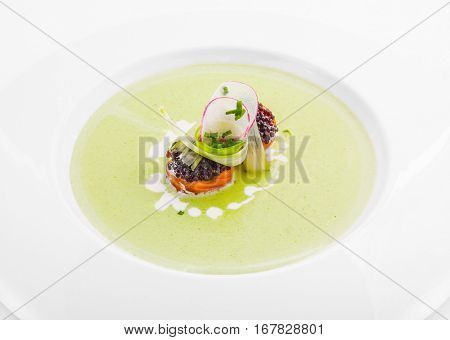 Exotic appetizer with caviar and herbs on plate
