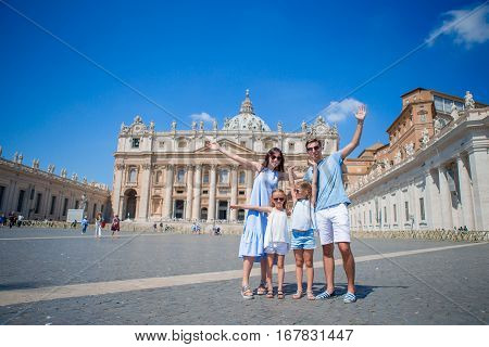 Happy family in Vatican city and St. Peter's Basilica church, Rome, Italy