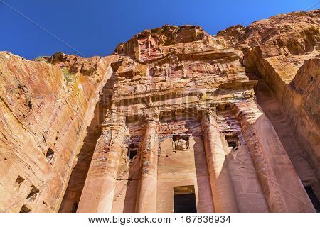 Royal Rock Tomb Arch Petra Jordan. Built by the Nabataens in 200 BC to 400 AD. Inside the Tombs the red orange white blue of the ceilings and arches create coloful designs and absctracts