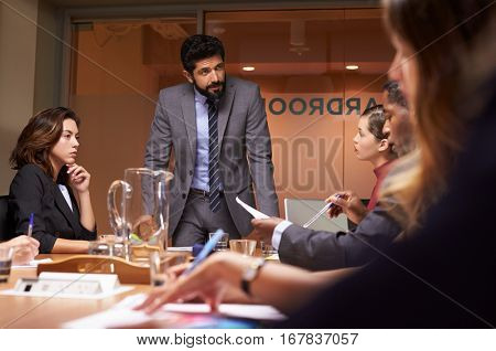 Businessman addressing team at a meeting, low angle close up