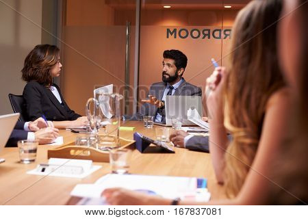 Business people at a meeting, close up, selective focus