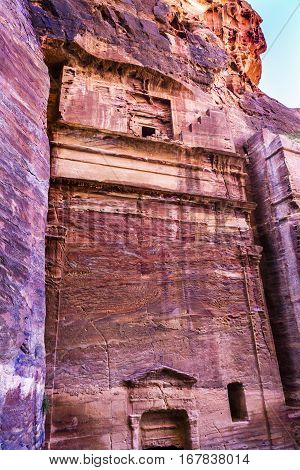 Rose Red Rock Tomb Street of Facades Petra Jordan. Built by the Nabataens in 200 BC to 400 AD. Rose Red canyon walls create many abstracts close up. Inside the Tombs the rose red can become blood red. Reds are created by magnesium in sandstone.