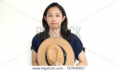 Cute Asian Woman Hide Face Behind Hat. Introvert And Antisocial Concept