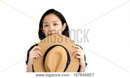 Cute Asian Woman Hide Face Behind Hat. Shy And Introvrt Concept