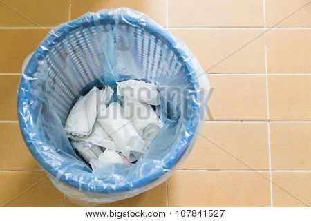 Used Sanitary Napkin Pad Wrapped And Disposed In Rubbish Bin