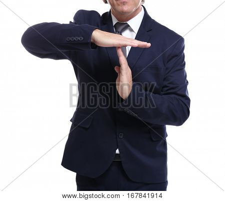 Close up view of man in suit showing timeout sign, on white background