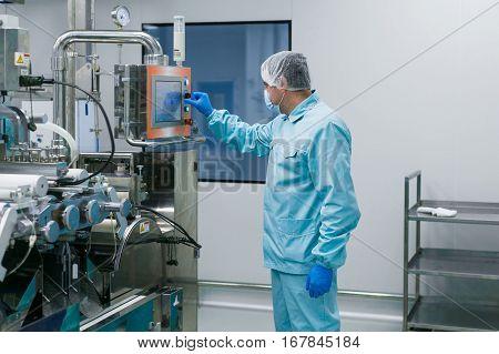 Scientist Configures Control Panel