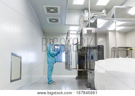 Scientist Stand Near Control Panel