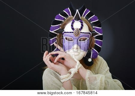 young blonde with a designer of theatrical mask