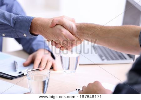Employer and applicant shaking hands at interview