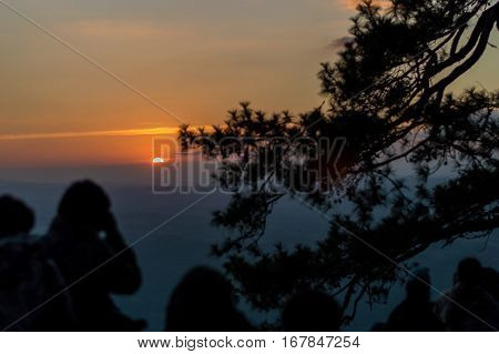Many Tourists Standing On The Top Of The Mountain Looking Sunset At Pha Lom Sak A Valley View At The