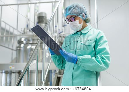 Plant Picture, Scientist Standing On Steel Stairs With Tablet