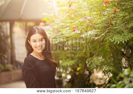 Smiling Girl Portraiture at the park.Young and pretty Thai girl.Close up