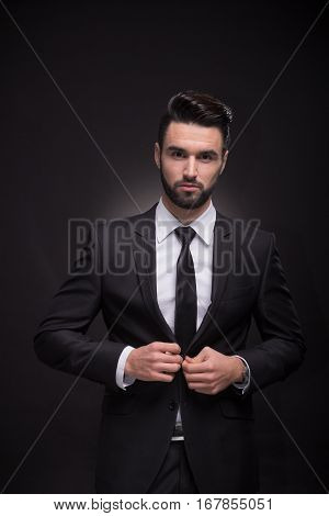 Young Man Elegant Suit, Looking At Camera, Black Background
