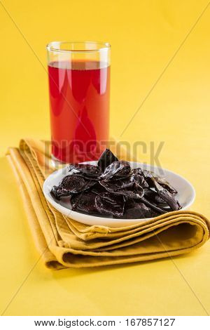 Kokum Sharbat - (a cold beverage) is a sweet and tangy drink made from the Kokum fruit or Garcinia indica