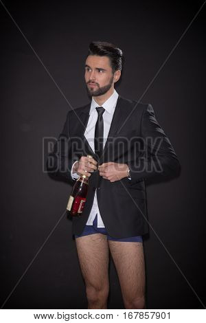 Young Man Undressing  Bottle Alcohol