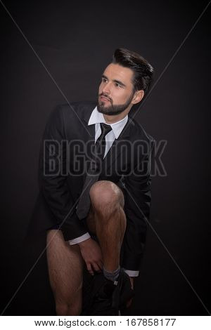 Young Man Undressing Pants Suit Jacket Tie Shirt
