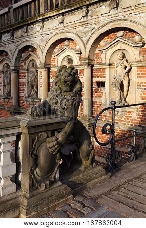 HILLEROD, DENMARK - DECEMBER 27, 2016: Sculpture of lion at the entrance to Frederiksborg Castle. It was built as a royal residence and becoming the largest Renaissance residence in Scandinavia