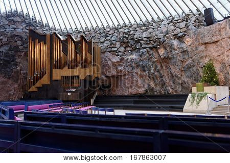 HELSINKI, FINLAND - NOVEMBER 26, 2016: Interior of Temppeliaukio Church also known as Church of the Rock. This Lutheran church was designed by brothers Timo and Tuomo Suomalainen and opened in 1969