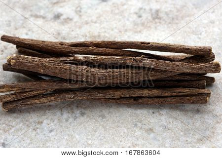 Bunch of liquorice sticks on a marble cutting board