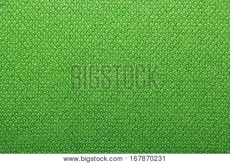 Knitted texture. Green wool. Knitted green background of natural wool