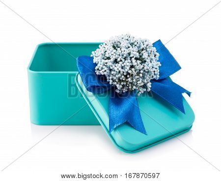 Open light blue gift box - Open light blue gift box with blue ribbon and white flowers isolated on white background. The file includes a clipping path so it's easy to work.