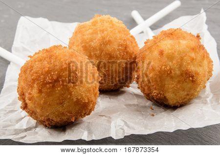 party food fried potato balls on white kitchen paper