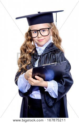 Portrait of a cute nine year old girl in an academic gown and hat. Educational concept. Isolated over white.