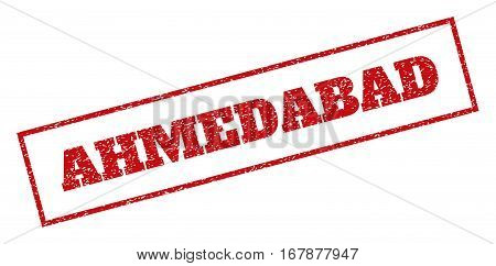 Red rubber seal stamp with Ahmedabad text. Vector tag inside rectangular shape. Grunge design and unclean texture for watermark labels. Inclined emblem.