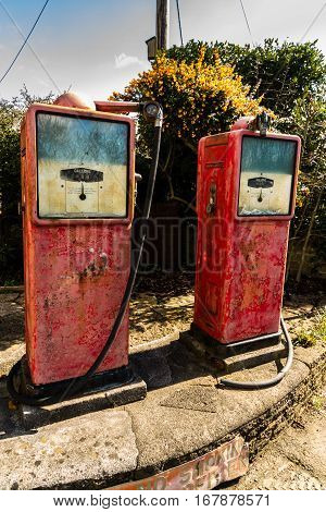 Two Old Vintage Petrol Pumps
