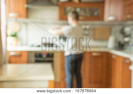 Blurred background. Cooking. Modern kitchen with bokeh light.