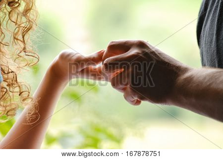 young Couple holding hands, close up, wedding