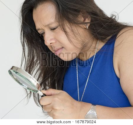 Woman Holding Magnification to Search