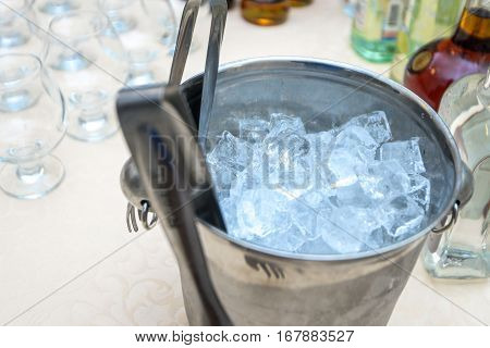 on the table a bucket with ice for drinks