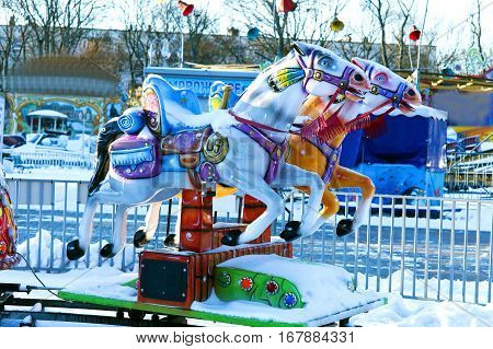 carousel horse in the winter the amusement Park out of season don't work the carousel