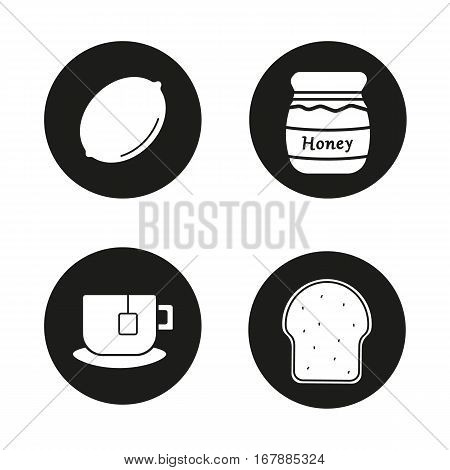 Breakfast items icons set. Lemon, covered honey pot, teacup on plate, toasted bread. Vector white silhouettes illustrations in black circles