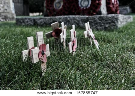 New Alresford, Uk - Jan 28 2017: Small Wooden Crosses With Poppies Commemorating Fallen Soldiers, On