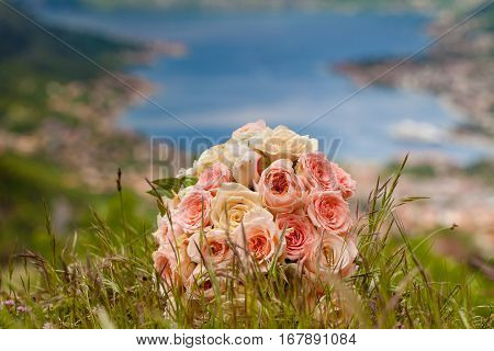 Bride's bouquet on the grass, sea background
