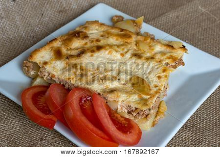 Moussaka - a traditional Balkan specialty with minced meat and potatoes poster