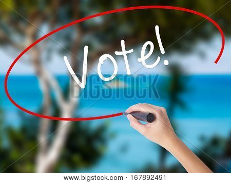 Woman Hand Writing Vote! With Black Marker On Visual Screen