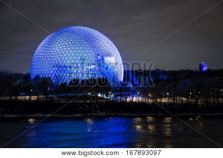 MONTREAL, CANADA - JANUARY 22, 2017: The Biosphere is a museum in Mtl.  It was the pavilion of the United States during Universal exposition in 1967 and now illumined for 375 anniversary of Montreal.