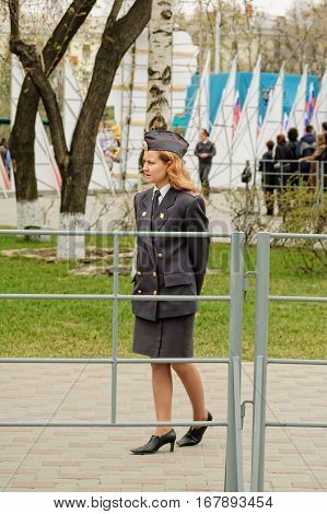 Tyumen, Russia - May 9. 2005: Victory Day holiday. Young policewoman - senior lieutenant stands and protects an order during parade