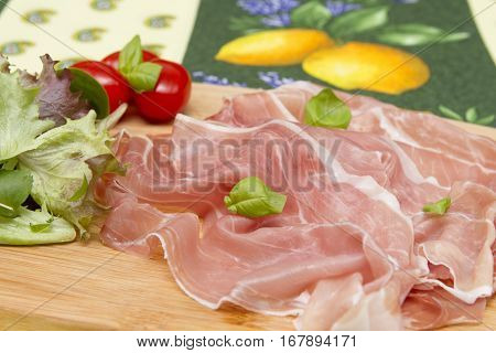 Cold Antipasti Cold Antipasti - Italian style antipasti with sliced ham, salad and tomatoes