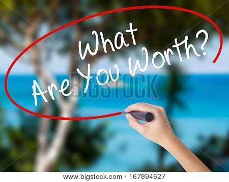 Woman Hand Writing What Are You Worth? With Black Marker On Visual Screen