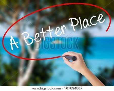 Woman Hand Writing A Better Place With Black Marker On Visual Screen