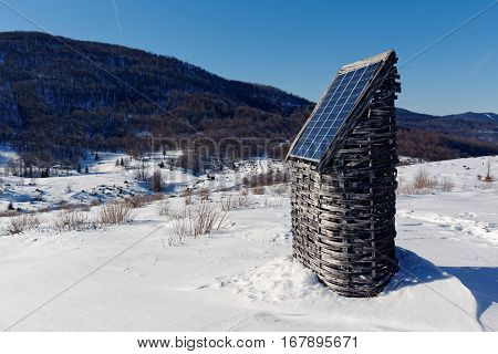 Homemade solar energy panel in winter. Solar panels are devices that convert light into electricity.