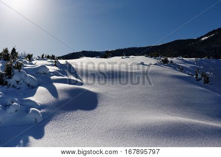 View Of Snow Covered Landscape. High mountain landscape with sun.Close Up Of Fresh Snow On Mountain.
