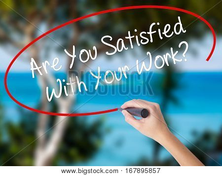 Woman Hand Writing Are You Satisfied With Your Work? With Black Marker On Visual Screen